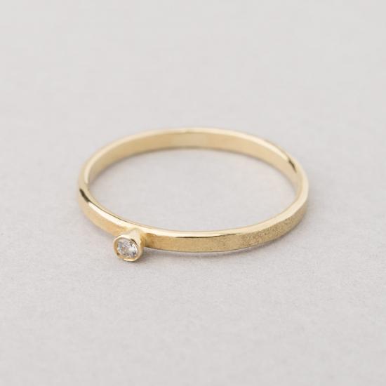 Hammered diamond ring.