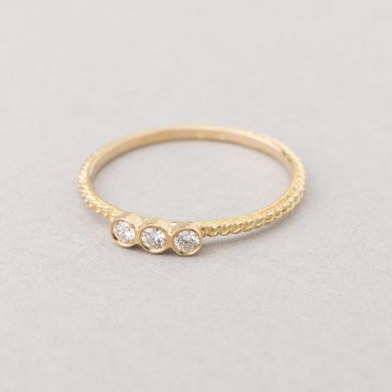 Ring with three diamonds.