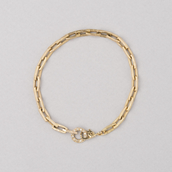 Thick bracelet with diamond clasp.