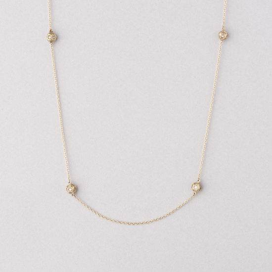 long necklace with diamond spheres