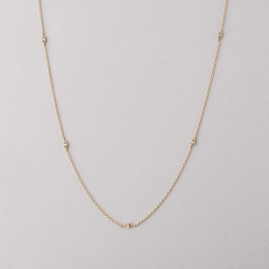 long necklace with diamond settings in between